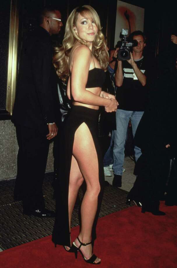 1998Full-length image of American singer and songwriter Mariah Carey in a halter top and long black skirt with a split up the side, New York City. Photo: Victor Malafronte, Getty / Archive Photos