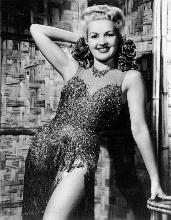 1945Promotional portrait of American actor Betty Grable posing in a slit sequined dress. Photo: Hulton Archive, Getty / Archive Photos