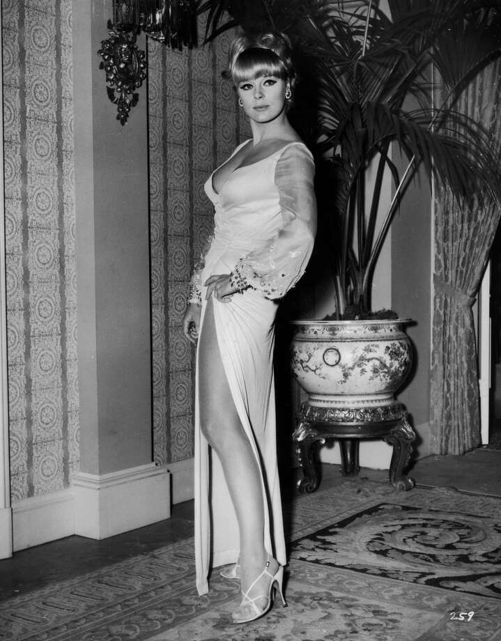 1964Full-length portrait of German actor Elke Sommer wearing a long gown with a high leg slit and a plunging neckline. Photo: Hulton Archive, Getty / Archive Photos