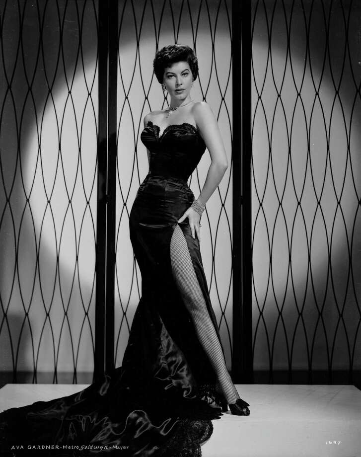 1952American actress Ava Gardner (1922 - 1990) wearing a full-length strapless gown with a slit up one side. Photo: Virgil Apger, Getty / Moviepix