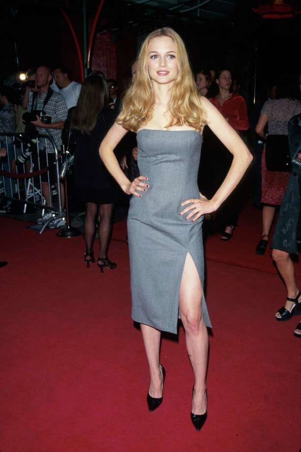 1997Actress Heather Graham, wearing gray dress w. slit down left leg, at film premiere of her Boogie Nights. Photo: Mirek Towski, Getty / Time Life Pictures