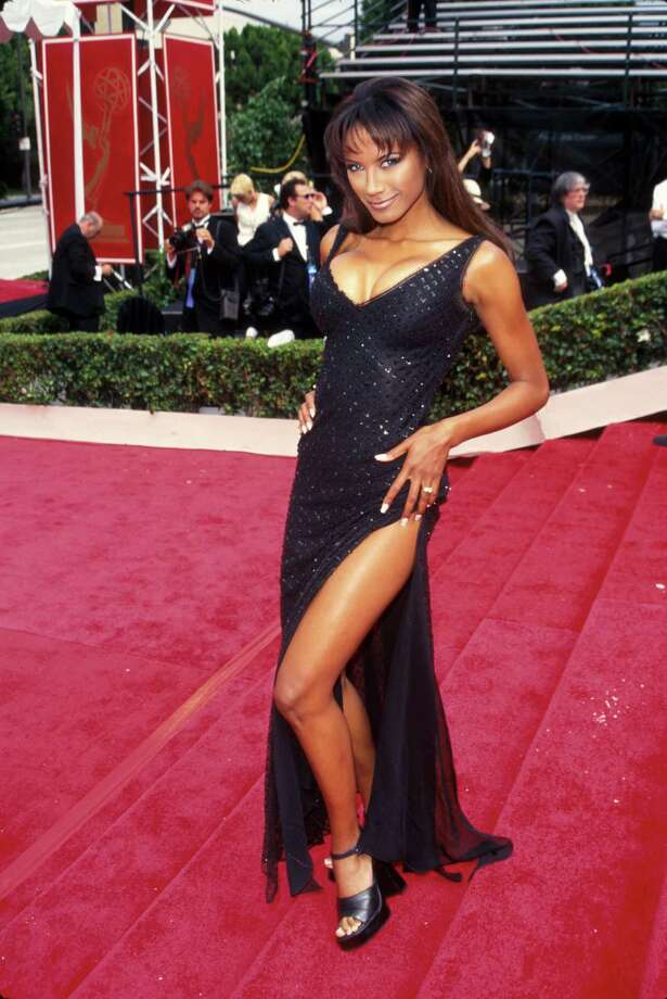 1997Actress Traci Bingham showing off gown w. slit down right leg. Photo: Mirek Towski, Getty / Time Life Pictures