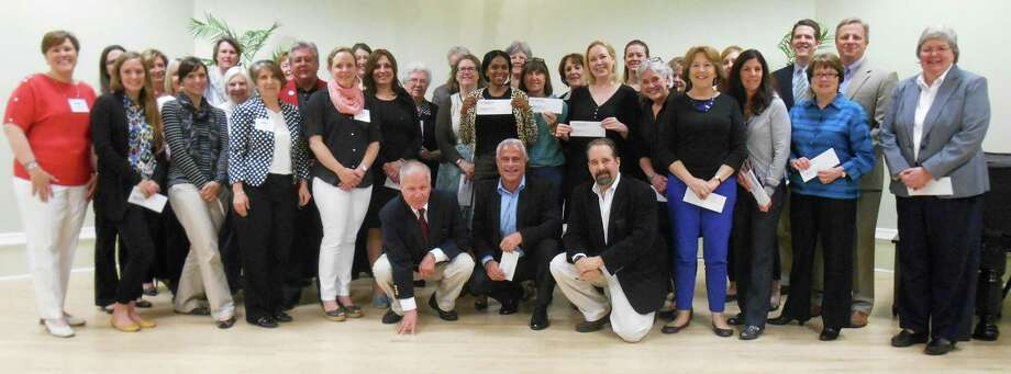 Represenatives from 38 local nonprofit organizations accepted grant checks from t he Westport Young Woman's League. Photo: Contributed Photo / Westport News