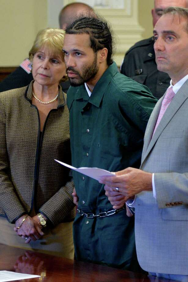 Alexis Torres, center,  appears for his arraignment on murder charges Tuesday afternoon, June 17, 2014, at Rensselaer County Court in Troy, N.Y. Flanking him is Sharon Dubuc a court appointed interpreter and John Turri Rensselaer County public defender.  (Skip Dickstein / Times Union) Photo: SKIP DICKSTEIN / 00027384A