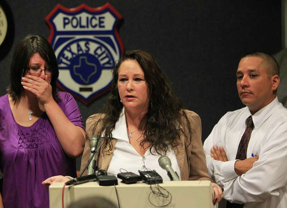 Tonya Huggins, left, weeps as her mother, Jeanie Escamilla, speaks at a press conference, Sept. 24, 2010, at the Texas City Police station. Police announced the arrest of suspect Kevin Smith in the 14-year-old death of Krystal Jean Baker, Escamilla's daughter. Thomas Huggins, Escamilla's son, listens. Photo: Mayra Beltran, Chronicle / Houston Chronicle