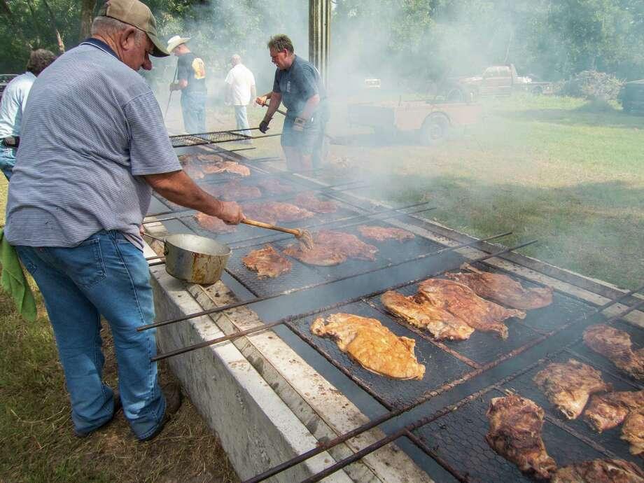 Tending the pits at the Millheim Harmonie Verein Community Barbecue. Photo: J.C. Reid