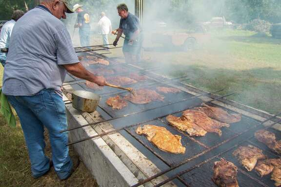 Tending the pits at the Millheim Harmonie Verein Community Barbecue.
