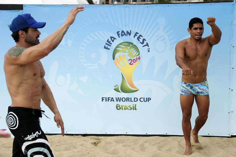 Do the Locomotion with me: The Fan Fest for the World Cup in Fotaleza, Brazil, has its own muscle beach. Photo: Marcio Jose Sanchez, Associated Press