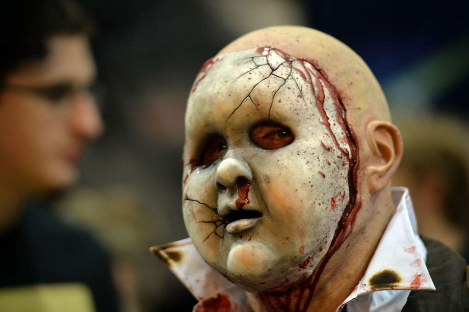 Enfant terrible:An abused baby with an adult-sized body - the alter-ego of one of thousands of Cosplay fans - makes a gruesome appearance at the Supanova Pop Culture Expo in Sydney. Photo: Peter Parks, AFP/Getty Images