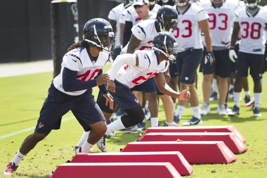 Texans cornerback Marcus Williams (40) and Jawanza Starling (29) warm up. Photo: Brett Coomer, Houston Chronicle