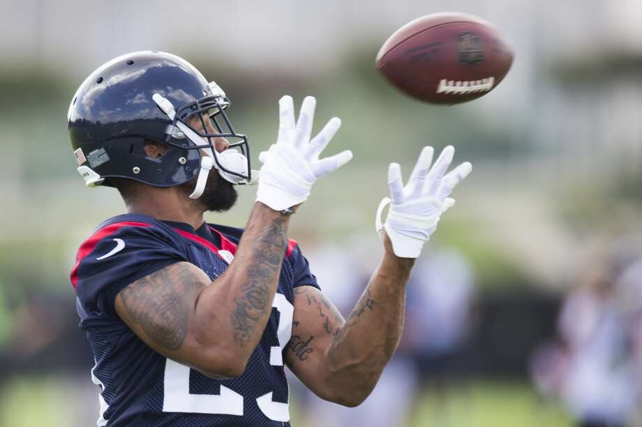 Texans running back Arian Foster reaches out to catch a pass. Photo: Brett Coomer, Houston Chronicle
