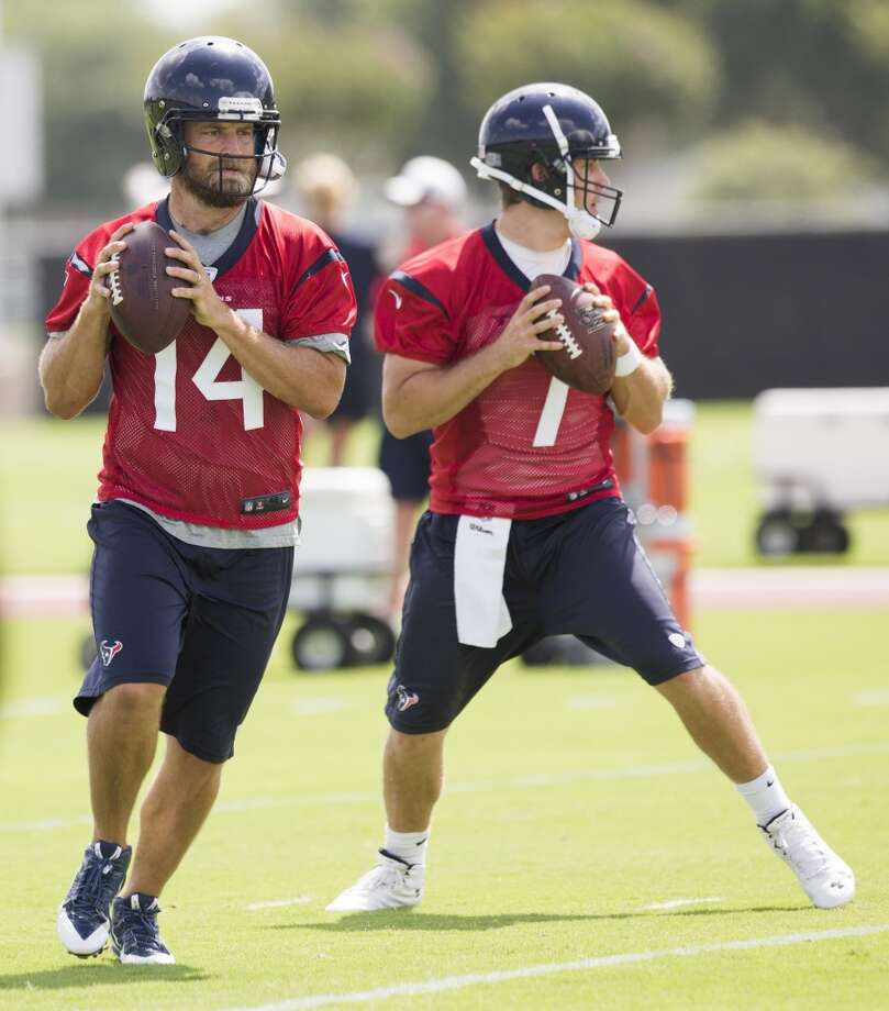 Texans quarterbacks Ryan Fitzpatrick (14) and Case Keenum (7) drop back to pass. Photo: Brett Coomer, Houston Chronicle