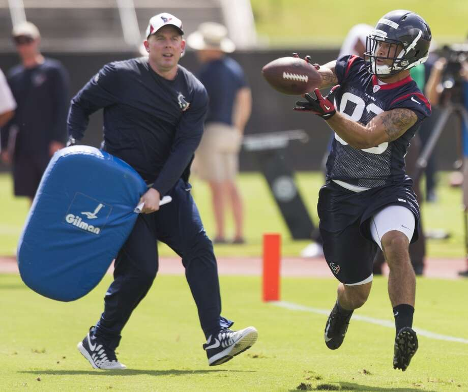 Texans wide receiver Kofi Hughes (83) reaches out to catch a pass with quarterbacks coach George Godsey trailing. Photo: Brett Coomer, Houston Chronicle