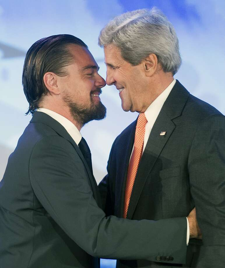 Leonardo DiCaprio hugs Secretary of State John Kerry after Kerry introduced him at the second day of the State Department's 'Our Ocean' conference at the State Department in Washington, Tuesday, June 17, 2014.  President Barack Obama is looking to create the largest marine preserve in the world by protecting a massive stretch of the Pacific Ocean from drilling, fishing and other actions that could threaten wildlife, the White House said. (AP Photo/Cliff Owen) Photo: Cliff Owen, Associated Press