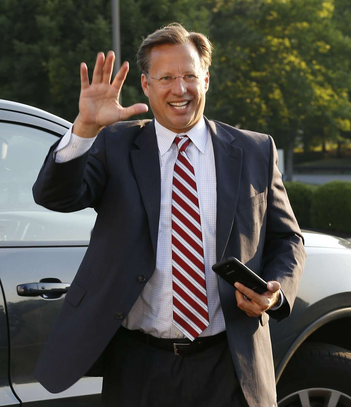 Republican 7th District congressional candidate Dave Brat waves as he arrives for a Rotary Club breakfast in Richmond, Va., Tuesday, June 17, 2014. Brat defeated House Majority Leader Eric Cantor in last week's Republican primary. (AP Photo/Steve Helber)