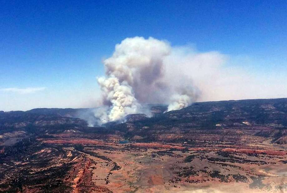 Smoke billows over the Chuska Mountains near Naschitti, N.M., on Sunday as strong winds fanned wildfire flames. Photo: Associated Press