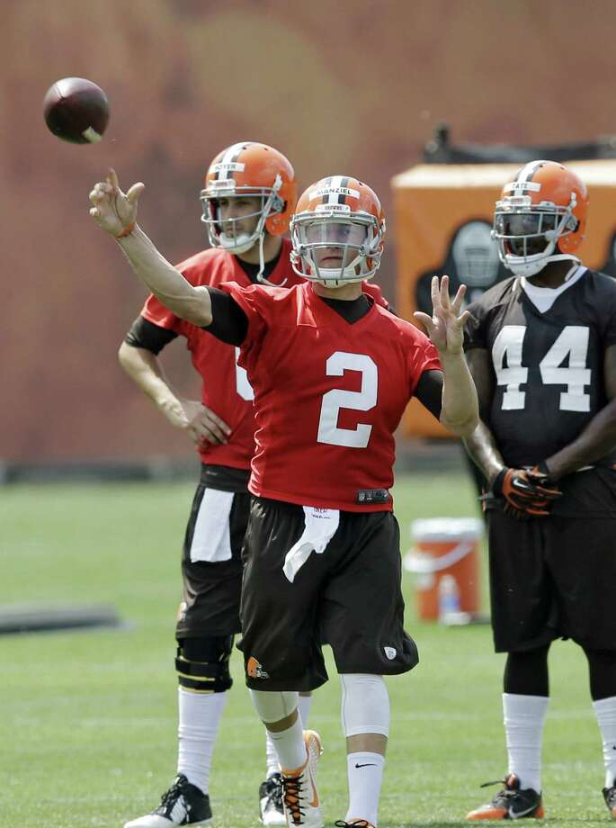 Cleveland Browns quarterback Johnny Manziel (2) tosses a ball  during a mandatory minicamp practice at the NFL football team's facility in Berea, Ohio. A reader points out that, historically speaking, Manziel is not alone when it comes to athletes who enjoyed having a good time. Photo: Mark Duncan / Associated Press / AP