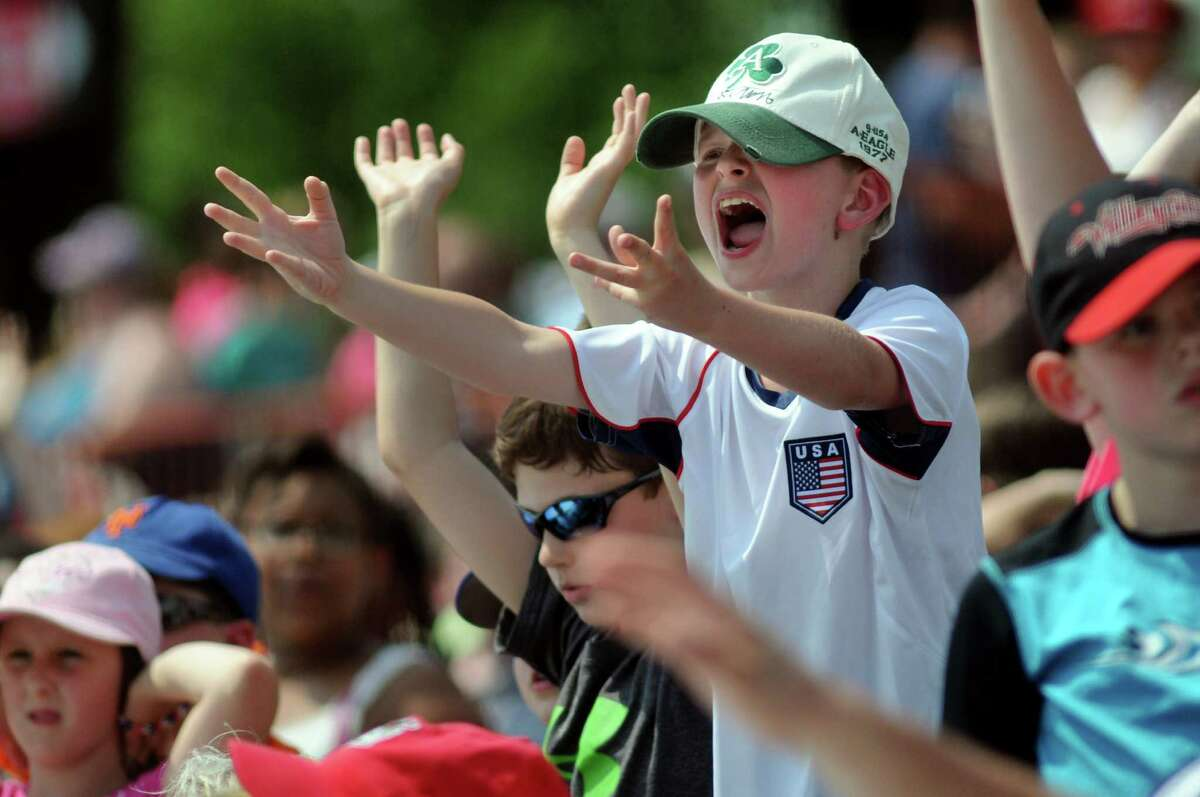 Dylan Sutton, 9, center, cheers for a T-shirt with his third-grade class from West Sand Lake Elementary at the ValleyCats vs. Lowell Spinners baseball game on Tuesday, June 17, 2014, at Bruno Stadium in Troy, N.Y. (Cindy Schultz / Times Union)