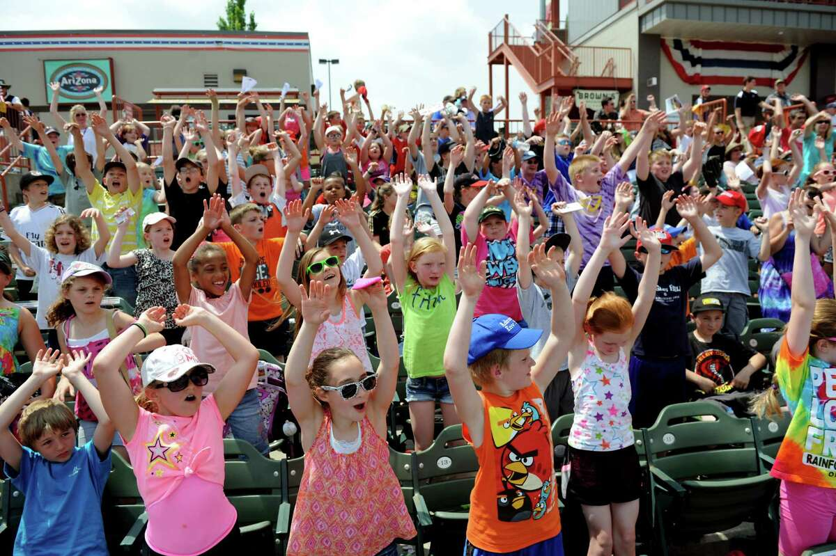 School children start the wave at the ValleyCats vs. Lowell Spinners baseball game on Tuesday, June 17, 2014, at Bruno Stadium in Troy, N.Y. (Cindy Schultz / Times Union)