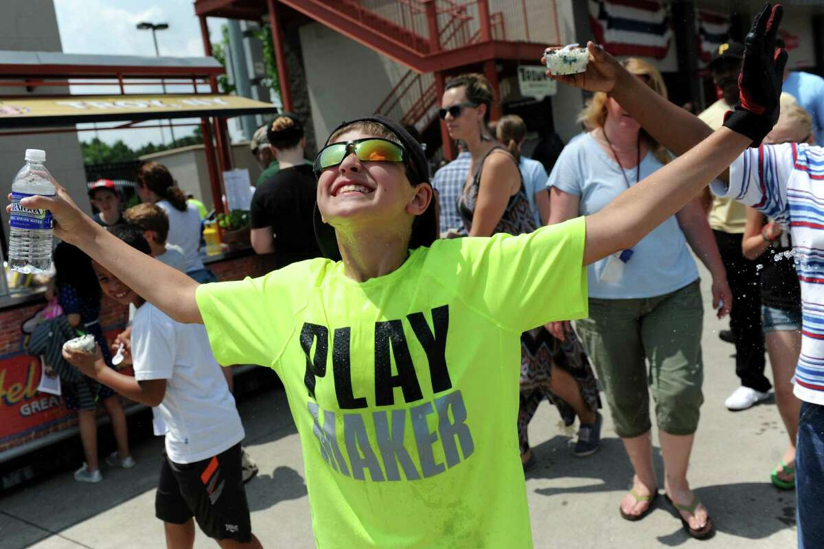 John Grant, 11, of Duanesburg Elementary asks for a spray of water at the ValleyCats vs. Lowell Spinners baseball game on Tuesday, June 17, 2014, at Bruno Stadium in Troy, N.Y. (Cindy Schultz / Times Union)