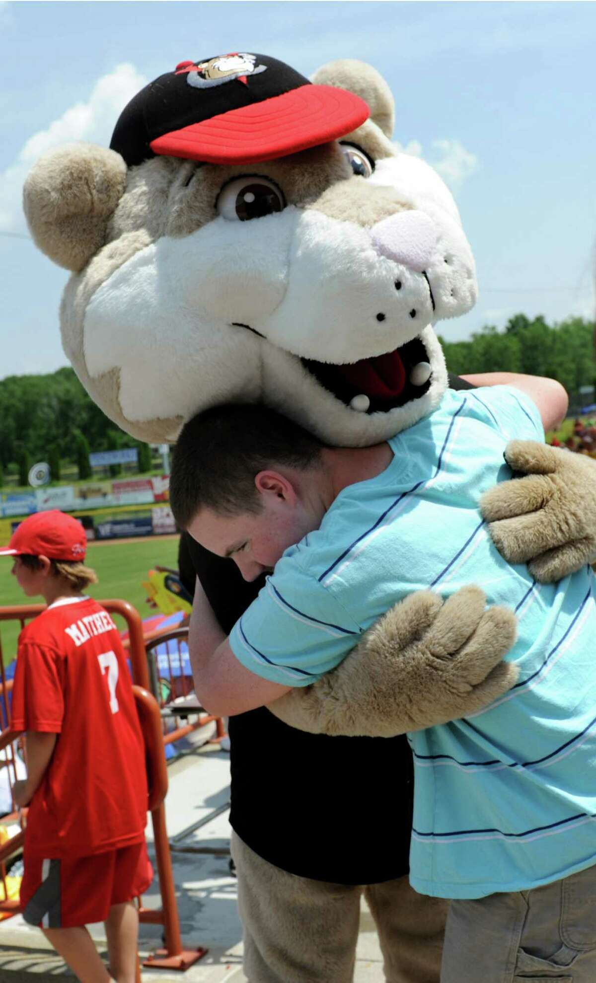 Mascot South Paw gets a hug from a young fan from Wildwood School at the ValleyCats vs. Lowell Spinners baseball game on Tuesday, June 17, 2014, at Bruno Stadium in Troy, N.Y. (Cindy Schultz / Times Union)