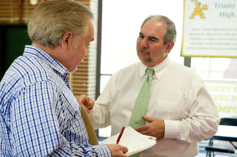 Trinity Catholic High School Principal Tony Pavia speaks with Director of Guidance John Carrigan at the end of the school day on Thursday, May 29, 2014. Pavia will retire at the end of this school year. Photo: Lindsay Perry / Stamford Advocate