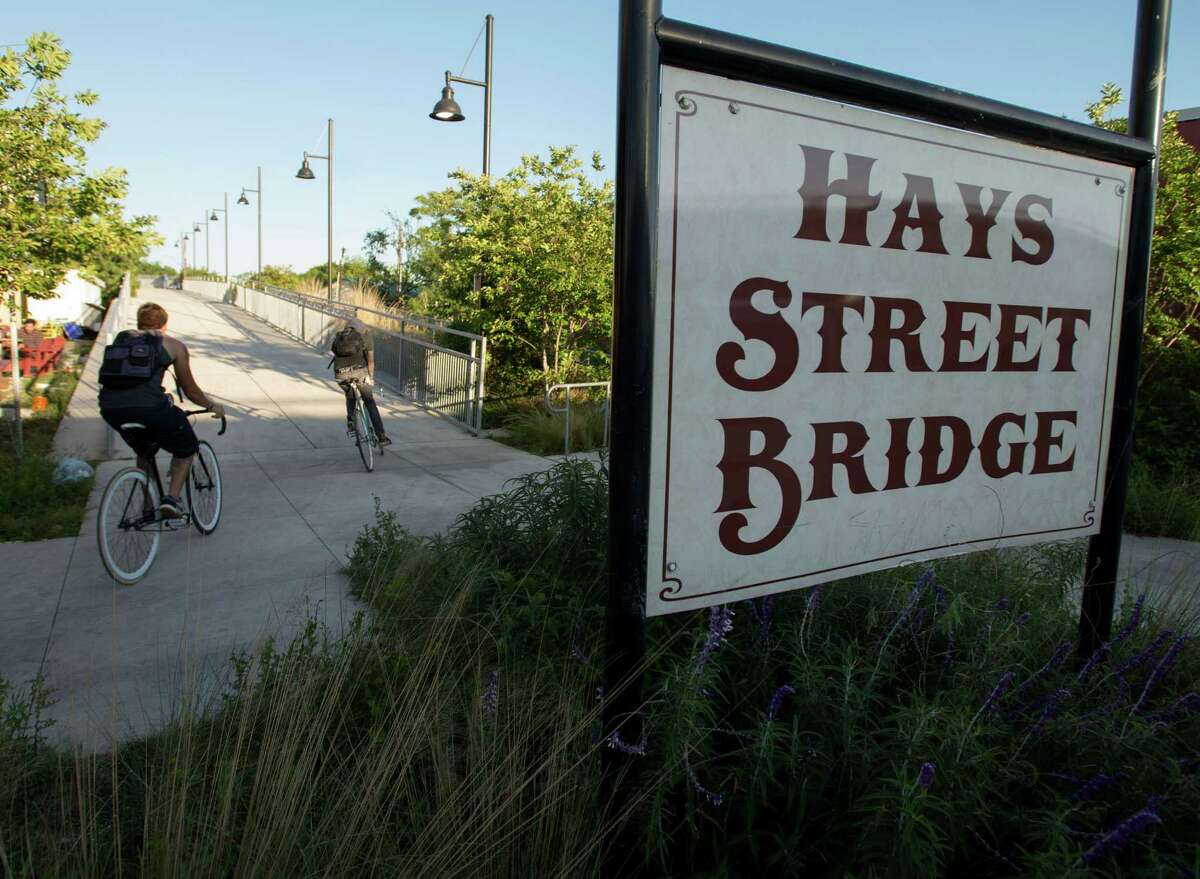 Cyclists ride onto the Hays Street Bridge, Friday, May 3, 2013, in San Antonio. (Darren Abate/For the Express-News)