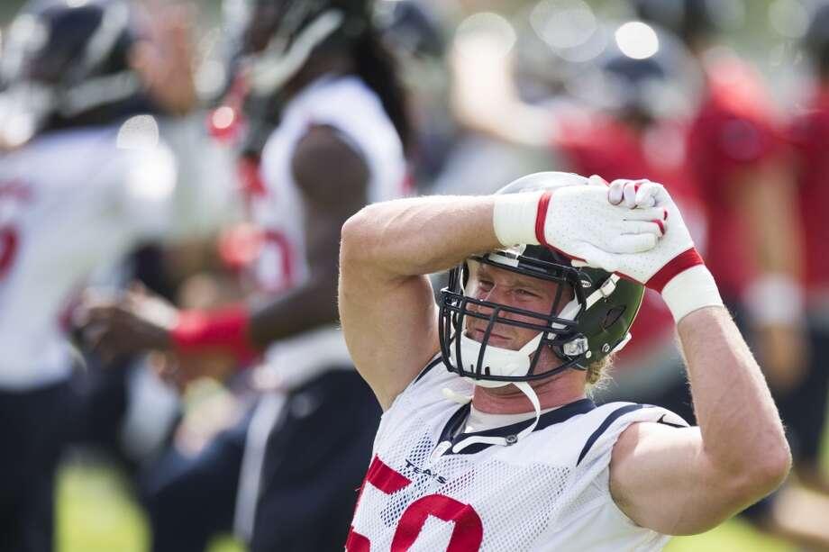 Texans linebacker Brooks Reed stretches. Photo: Brett Coomer, Houston Chronicle