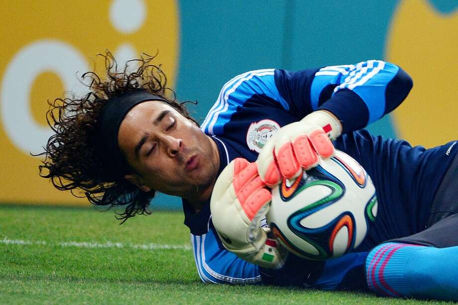 Mexico's goalkeeper Guillermo Ochoa makes a save during a Group A football match between Brazil and Mexico in the Castelao Stadium in Fortaleza during the 2014 FIFA World Cup on June 17, 2014. AFP PHOTO / YURI CORTEZYURI CORTEZ/AFP/Getty Images