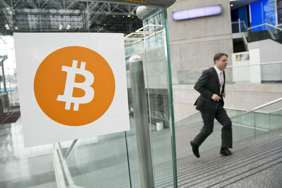 FILE - In this April 7, 2014 file photo, a man arrives for the Inside Bitcoins conference and trade show in New York. The Bitcoin digital currency system is in danger of losing its credibility as an independent payment system because of the growing power of a group that runs the some of the computers behind it. (AP Photo/Mark Lennihan, File) Photo: Mark Lennihan, Associated Press