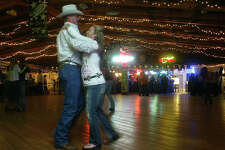 Victoria residents Brian Morris, 38, and his wife, Hollie, 37, two-step the night away at Schroeder Hall in Schroeder. SHAMINDER DULAI / HOUSTON CHRONICLE