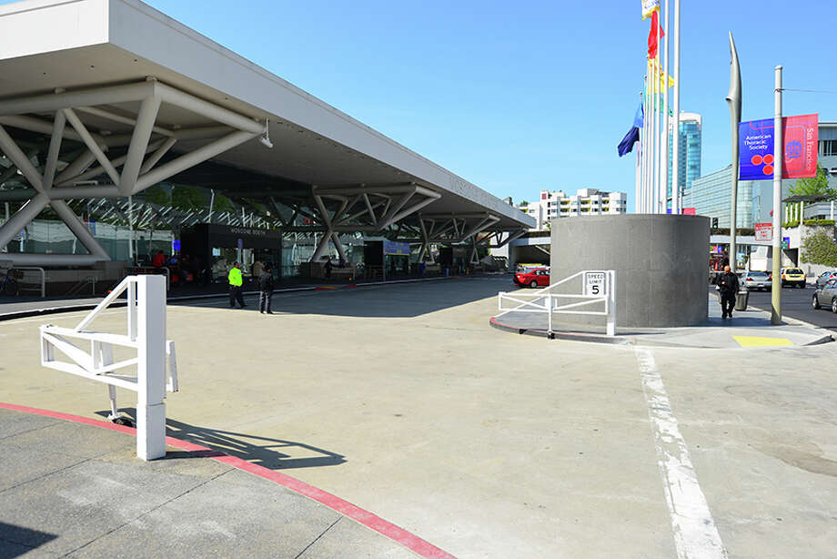 The first piece of Moscone Center, completed in 1984, has a large porte-cochere that cuts it off from the street. The proposed expansion would extend to the sidewalk and climb 95 feet. Photo: Courtesy SOM