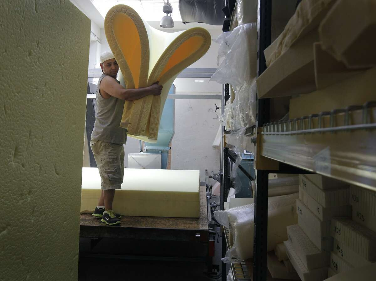 Employee Saul Ordonez carries foam free of flame retardants at the Foam Order store in San Francisco.