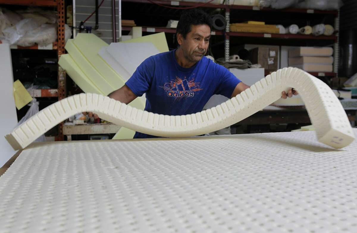 Jose Galvan works with nontoxic foam at Foam Order, one of four Bay Area stores taking part in the foam exchange.