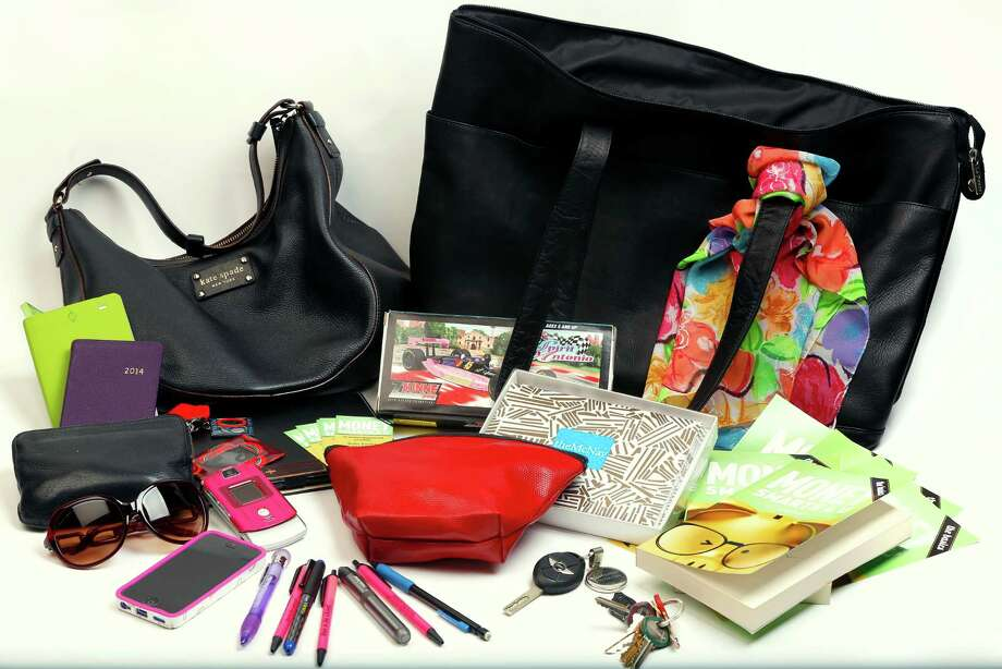 "Contents include copies of her book, ""MoneySmarts4U: The Basics,"" a mini iPad, phones and notecards, plus two smaller totes inside a large one. Photo: William Luther, San Antonio Express-News / © 2014 San Antonio Express-News"