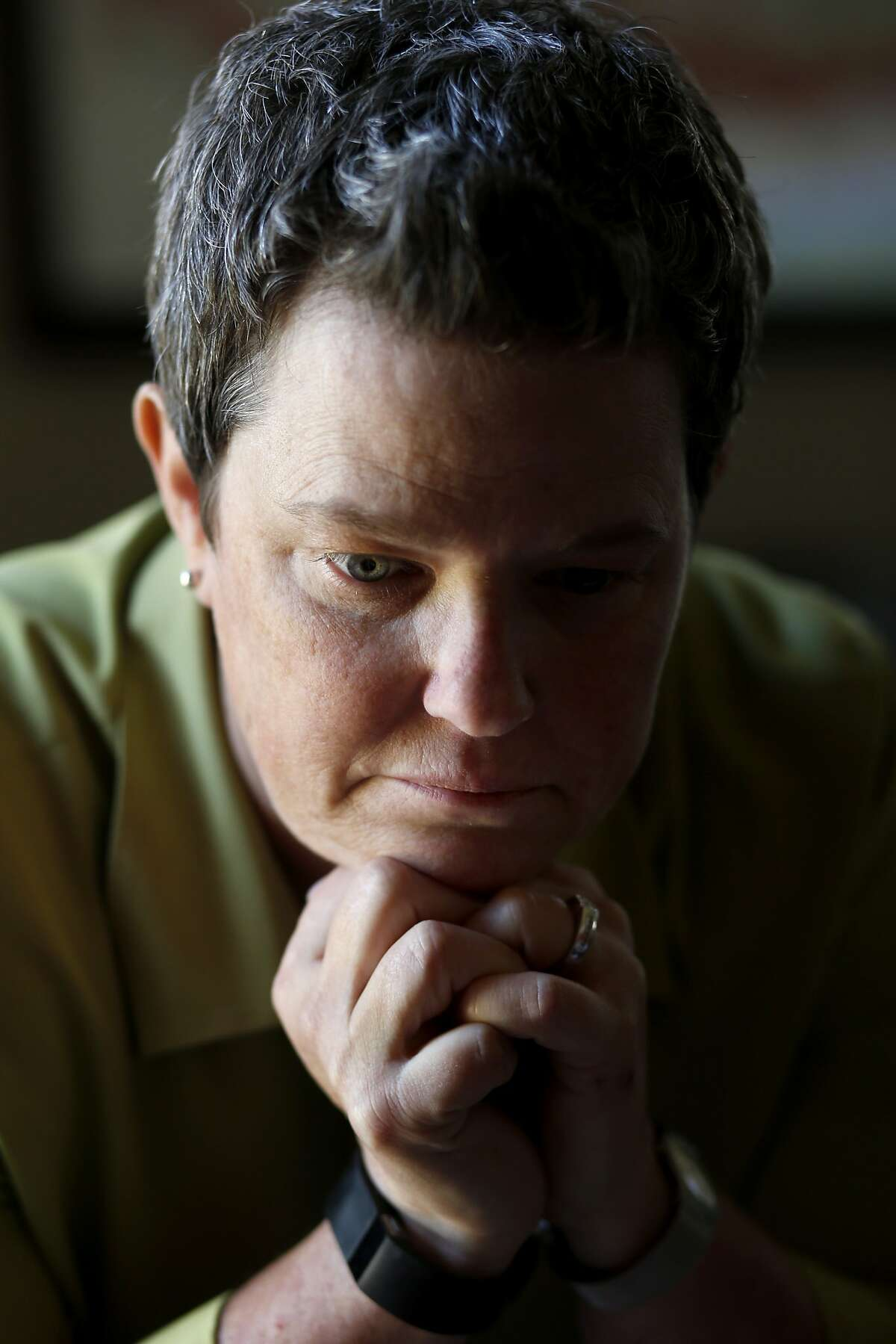 Iraq War veteran Kelly McFarland suffered from PTSD after returning from the war. She pauses in the living room of her Livermore, Calif home Tuesday June 17, 2014. Kelly McFarland, a veteran of the Iraq War, has been following the recent events in that part of the world with great interest.