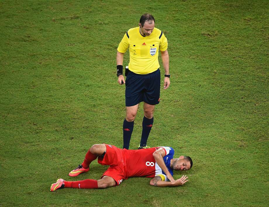 NATAL, BRAZIL - JUNE 16:  Clint Dempsey of the United States lies on the field as referee Jonas Eriksson stands over him during the 2014 FIFA World Cup Brazil Group G match between Ghana and the United States at Estadio das Dunas on June 16, 2014 in Natal, Brazil.  (Photo by Laurence Griffiths/Getty Images) Photo: Laurence Griffiths, Getty Images