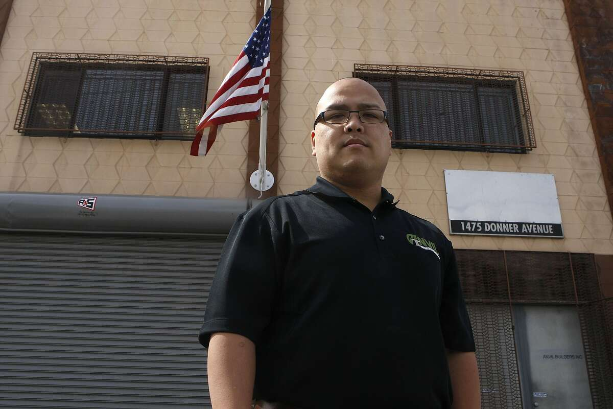 CEO and president Hien Manh Tran waiting for UPS outside of his building at Anvil Builders in San Francisco, Calif., on Monday, March 18, 2013. He says he is the only business on the block displaying the american flag.
