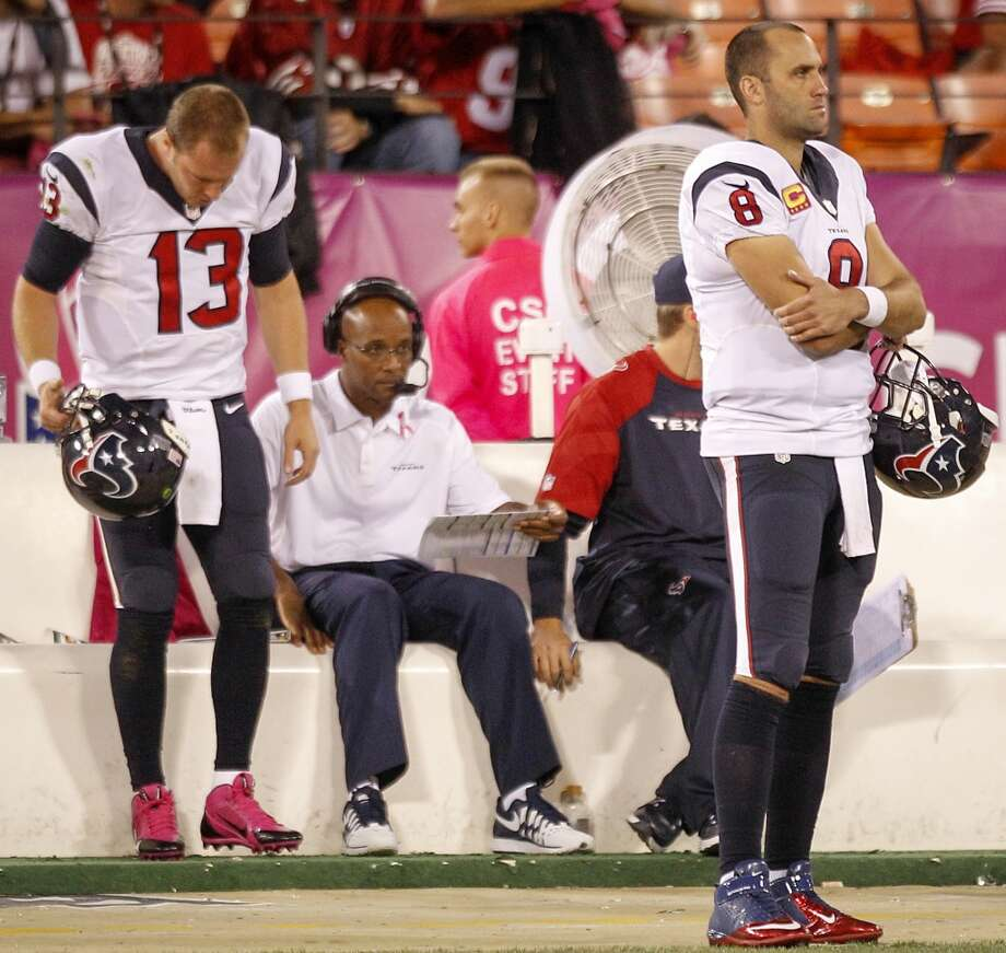 Texans quarterback T.J. Yates stands behind Matt Schaub. Photo: Brett Coomer, Houston Chronicle