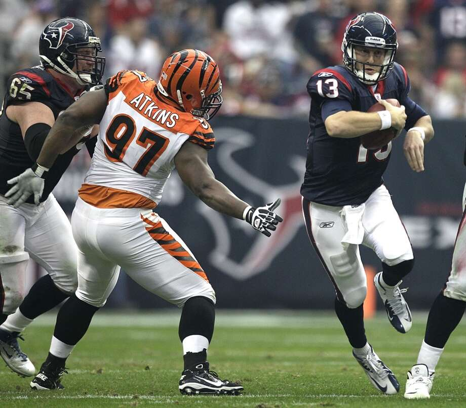 Texans quarterback T.J. Yates tries to elude a Bengals defender during a 2012 playoff game. Photo: Brett Coomer, Houston Chronicle