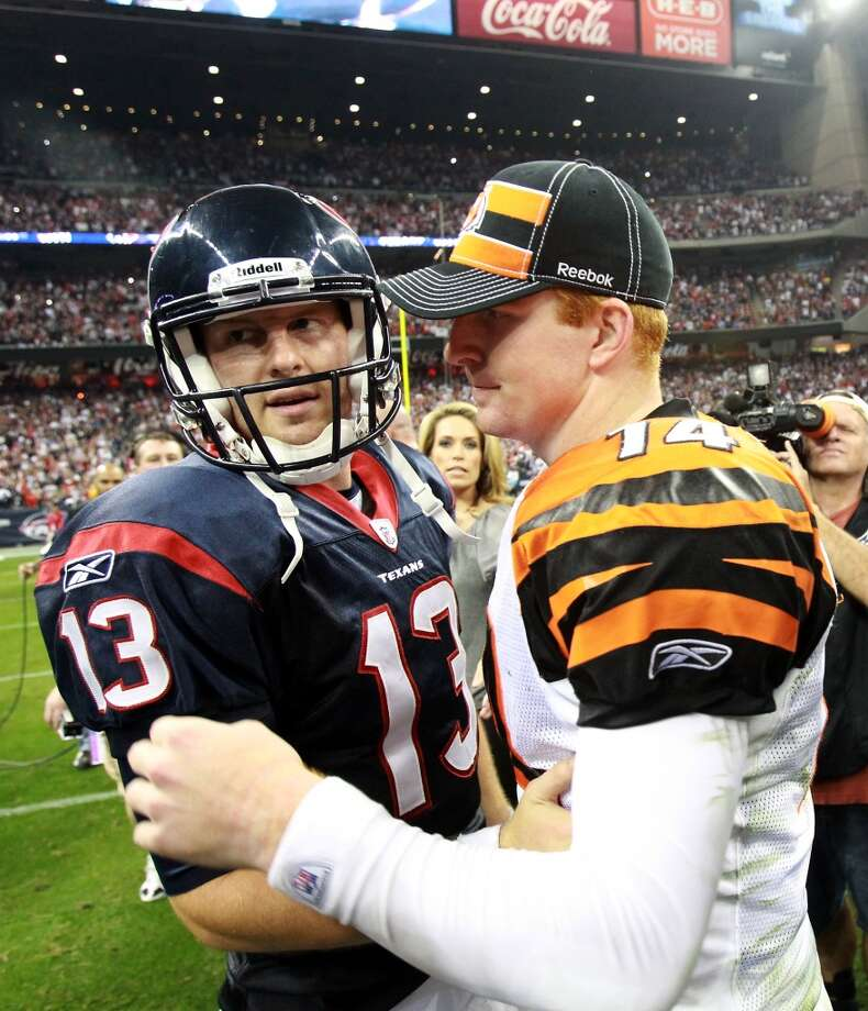 Texans quarterback T.J. Yates greets Andy Dalton after Houston defeated the Bengals in a 2012 wild-card game. Photo: Nick De La Torre, Houston Chronicle