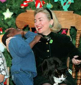 Then-first lady Hillary Rodham Clinton in 1996 with Kwadwo Nyamekye Asante, 6, a patient at Washington's National Medical Center. Ron Edmonds/Associated Press