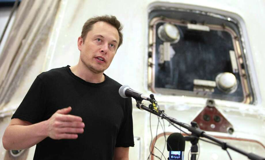 FILE - In this June 13, 2012 file photo, SpaceX CEO Elon Musk answers questions in front of the SpaceX Dragon spacecraft  at the SpaceX Rocket Development Facility in McGregor, Texas. SpaceX filed a lawsuit Monday, April 28, 2014, that challenges a contract awarded to a joint venture between Boeing and Lockheed Martin to supply 36 rocket cores to the Air Force to send national security equipment into space. SpaceX says the contract should have been open to other bidders and the suit calls for certain launches to be open to competition. (AP Photo/Waco Tribune-Herald, Duane A. Laverty, File) ORG XMIT: TXWAC201 Photo: Duane A. Laverty / The Waco Tribune-Herald