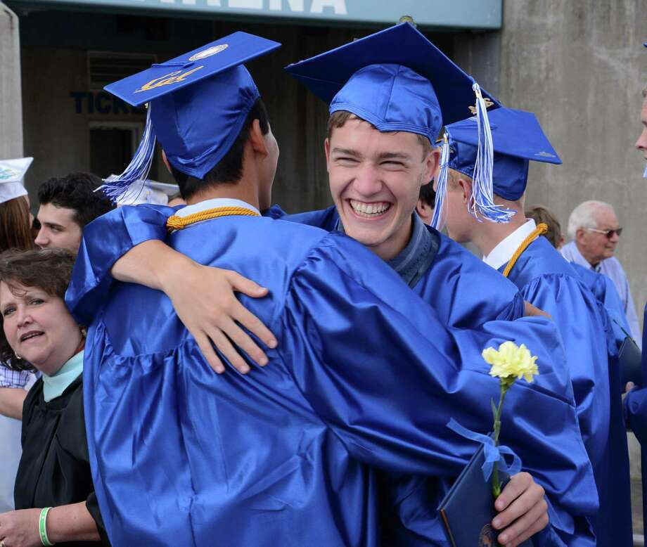 Ian Lew, right, and Don Sun congratulate each other after Newtown High Schools Commencement Ceremony is completed on Tuesday June 17, 2014. Photo: Lisa Weir / The News-Times Freelance