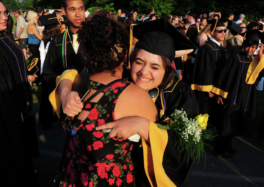 Graduate Tori Vergara gets a hug from her friend Asia Coby, after the conclusion of Jonathan Law High School's Class of 2014 Graduation Ceremony in Milford, Conn. on Tuesday June 17, 2014. Photo: Christian Abraham / Connecticut Post