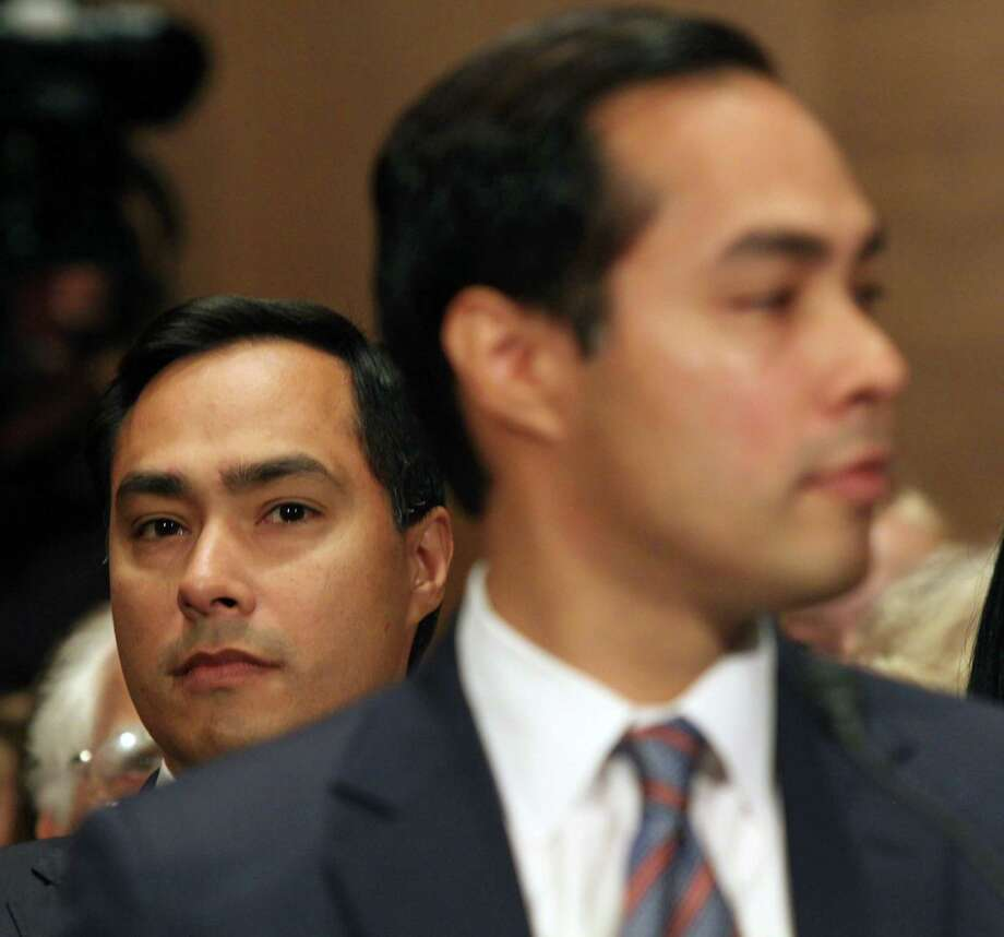 Rep. Joaquin Castro, D-Texas listens at left as his brother, Housing and Urban Development Secretary nominee, San Antonio, Texas Mayor Julian Castro testifies on Capitol Hill in Washington, Tuesday, June 17, 2014, before the Senate Banking Committee hearing on his nomination.  (AP Photo/Lauren Victoria Burke) Photo: Lauren Victoria Burke, FRE / FR132934 AP