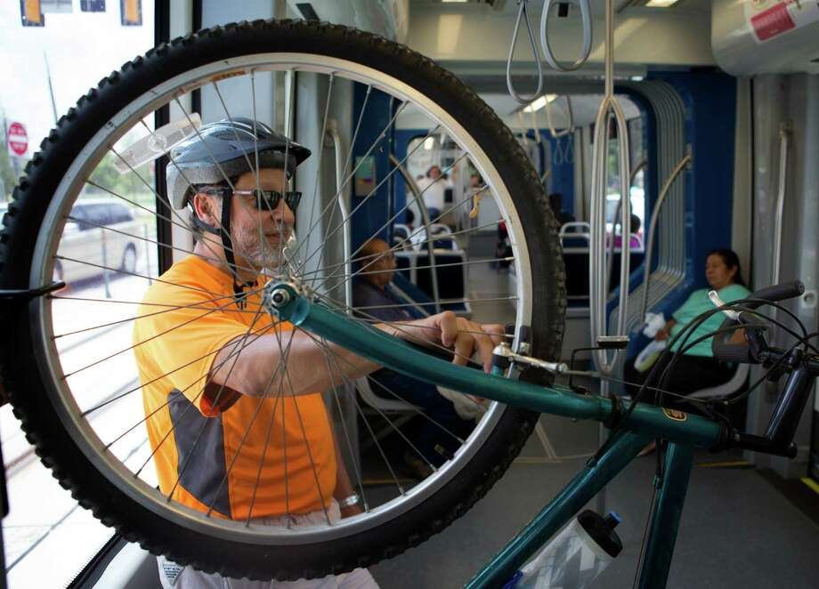 Longtime Lindale Park resident and cyclist Bob Falcon says the area's wait for rail service was worth it. Photo: Cody Duty, Staff / © 2014 Houston Chronicle