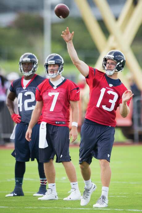 T.J. Yates (13) took part in minicamp Tuesday morning but was out of a job by the end of the day. Photo: Brett Coomer, Staff / © 2014 Houston Chronicle