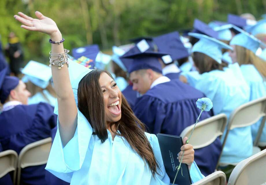 Graduate Mariah Ferrante waves to her family in the audience during Oxford High School's commencement ceremony Tuesday, June 17, 2014 on the football field. Photo: Autumn Driscoll / Connecticut Post