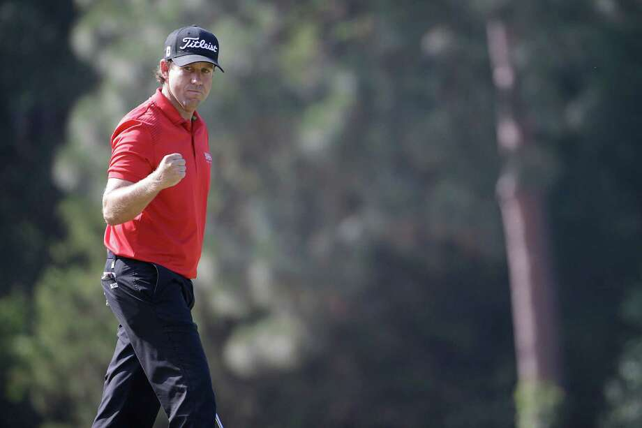 Erik Compton reacts to his birdie on the eighth hole during the final round of the U.S. Open golf tournament in Pinehurst, N.C., Sunday, June 15, 2014. (AP Photo/David Goldman) Photo: David Goldman, Associated Press / Associated Press